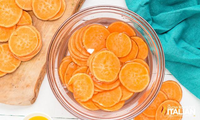 soaking sweet potato slices