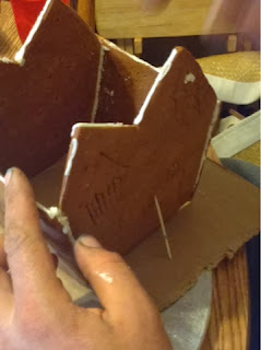 Toothpicks can help keep the house from falling apart while the royal icing dries