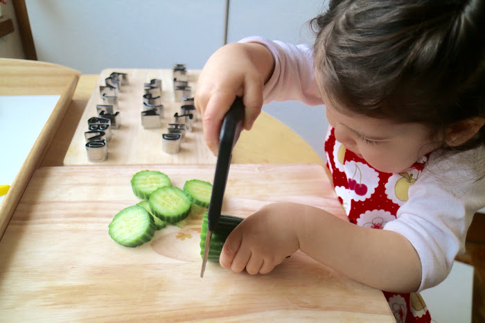 Cutting and slicing food, cutting materials Montessori, independence children Montessori, kitchen activities children, toddler activities kitchen, banana slicer, strawberry slicer, Montessori kitchen,