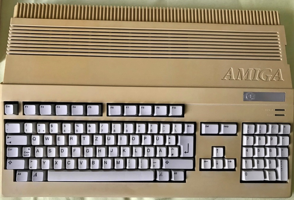 Bleached keyboard, in still yellowed Amiga case.