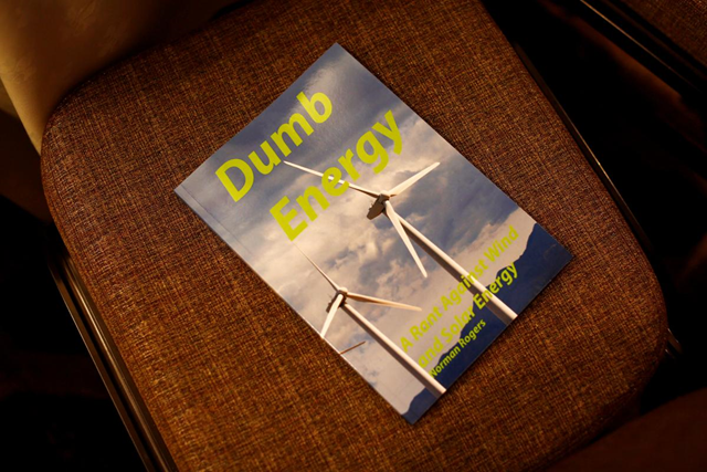 Literature left on a chair during the Heartland Institute's America First Energy Conference 2018 in New Orleans, Louisiana, 7 August 2018. The cover of the book reads, 'Dumb Energy: A Rant Against Wind and Solar Energy' by Norman Rogers. Photo: Edmund D. Fountain / REUTERS