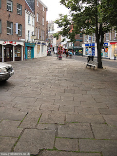 2012. Paving in foreground is on the raised area of the square