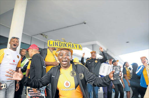 RED CARPET: Kaizer Chiefs fans at East London Airport welcome the team arriving for their clash against Chippa United today Picture: SIBONGILE NGALWA