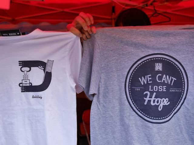 "shirts with ""Democracy"" and ""We Cant Lose Hope For Democracy"""