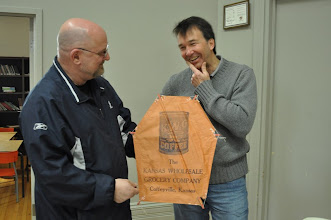 Photo: George and Mark with a barn door paper kite.