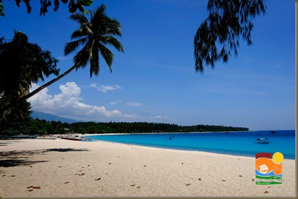 Dahican Beach, Mati on a calm day. The waves here reach Hawaii-like strength and height later in the year.