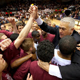 Head University of Montana Men's Basketball Coach, WayneTinkle, celebrates with the team after winning the 2012 Big Sky Conference Championship.  Photo by Patrick Record
