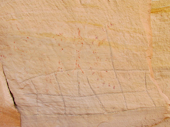 Petroglyph (rubbed with charcoal) and pictographs that appeared to be partially rubbed out