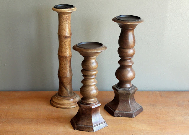Chunky wooden pillar holders from the rental inventory of www.momentarilyyours.com