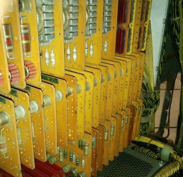A closeup of SMS cards inside an IBM 1406 Storage Unit. The top cards have heat sinks on high-current driver transistors.
