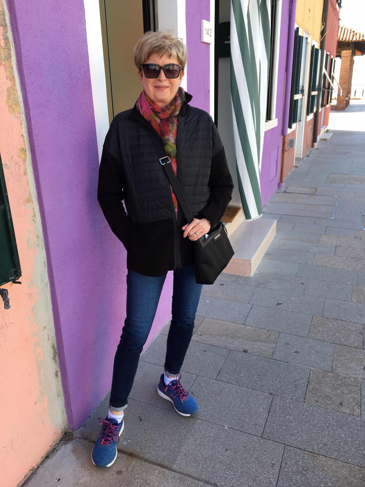 colorful houses, and woman smiling on Burano Island, Venice