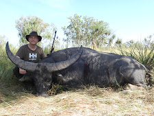Mr Peter Jensen, Denmark, with a great old buffalo bull, taken at 25 yards in long grass
