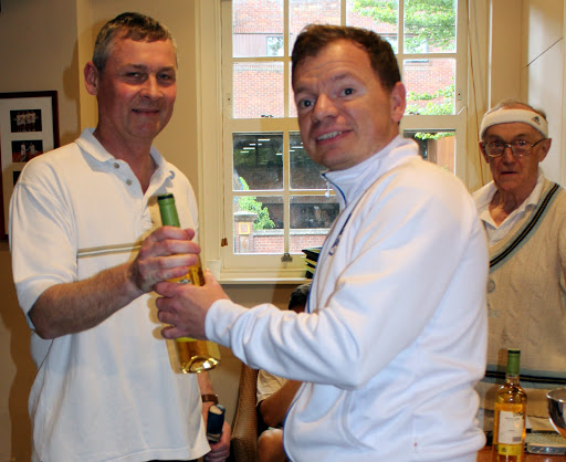 Chris Egleton, Gruduate Cup RU, receives some consulation from Scott as the Senior Treasurer looks concerned...