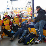 Crew Members Rob Inett and Joe Manning assessing one of the casualties on Dolphin III in a training exercise -  22 April 2014 Photo: RNLI Poole/Anne Millman
