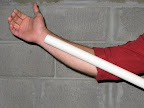 Cut down a length of PVC pipe to the size of a forearm