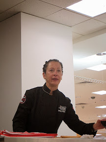 Culinary Council Recap: Nancy Silverton, Culinary Council member at the Macy's at Washington Square Dec 14, 2013, doesn't drink white wine (thus the glass of red) and also approves of having red towels in your holiday kitchen