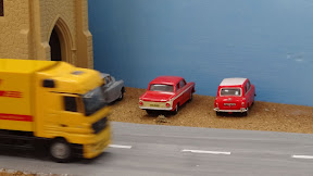Moving DHL truck on invisible tracks on train set