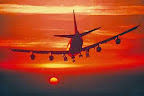 jumbo jet silhouette flying into orange sunset