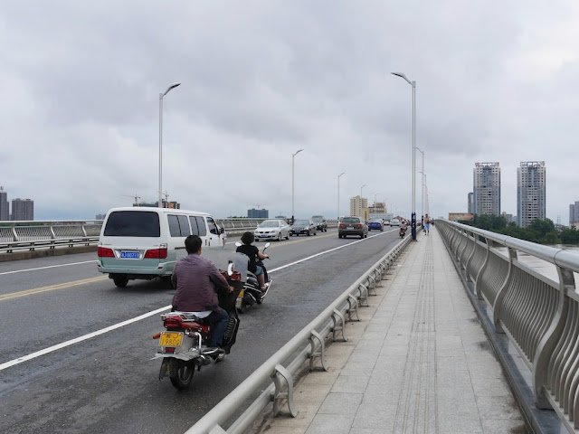 motorbikers using the road on a bridge