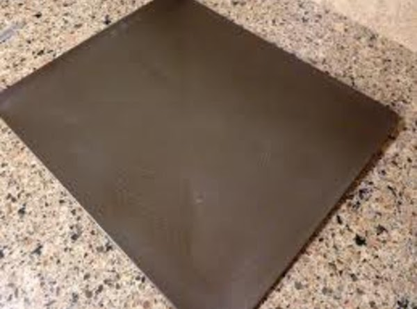 Spray a cookie sheet with Pam or other cooking spray.