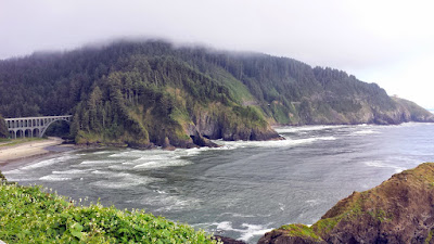 At Heceta Head Lighthous Viewpoint, the view of Cape Creek Cove and Cape Creek Bridge