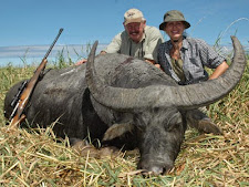 Reiner & Marita Schafer with another nice buffalo bull taken with Australia Wide Safaris at Carmor Plains