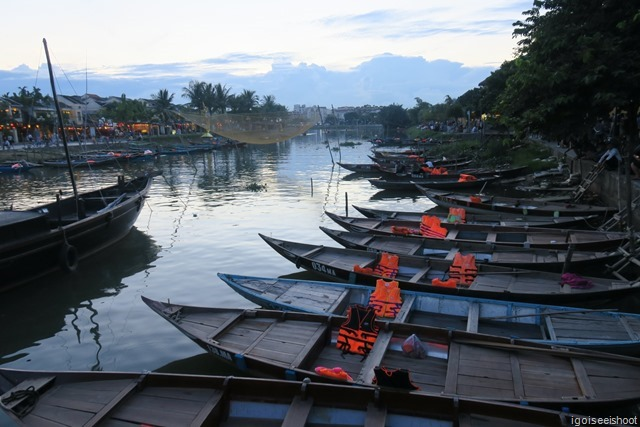 Hoi An - View of the river and the wooden boats in the evening