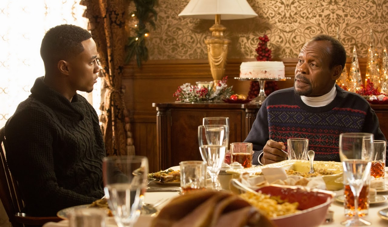 (L to R) Jessie T. Usher and Danny Glover in ALMOST CHRISTMAS. (Photo by Quantrell D. Colbert / courtesy of Universal Pictures).