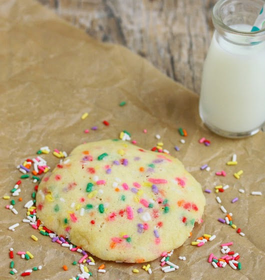photo of a sugar cookie with sprinkles