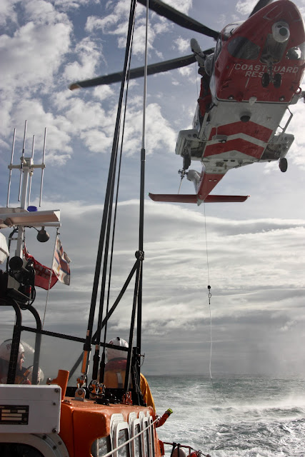 9 October 2011. HM Coastguard Helicopter 106 preparing to winch onto Poole Lifeboat. Photo:Poole RNLI/Ade