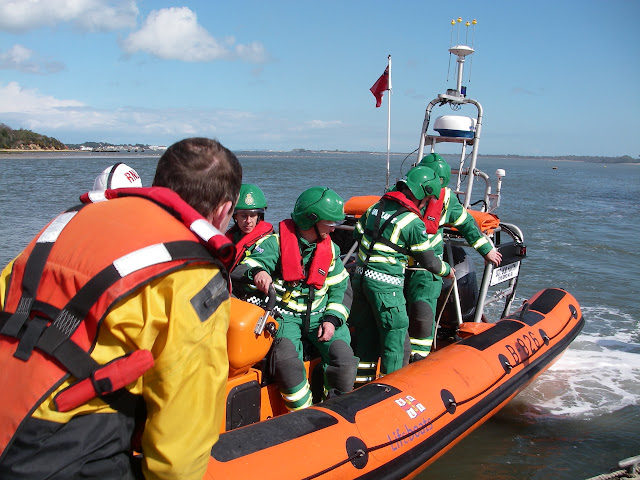 20 April 2012 - A new hazardous area response team arriving at Green Island by inshore lifeboat so they could provide the firefighters with medical cover. Photo: RNLI/Poole Lifeboat Station Anne Millman