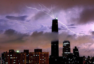 Photo: Lightning strike over the sky above Guangzhou International Finance Center  during a rainstorm in Guangzhou, south China's Guangdong province, Wednesday, June 3, 2009. (AP Photo) ** CHINA OUT **