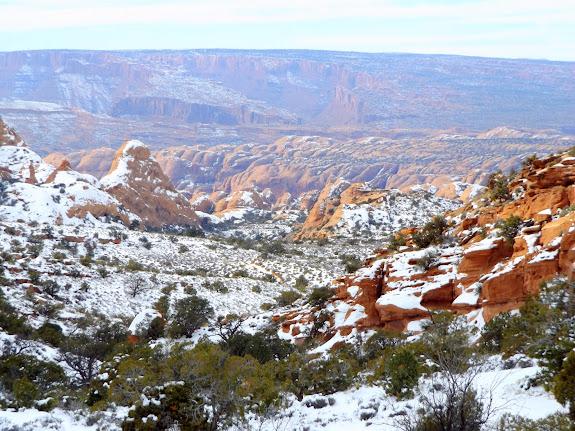 View northwest from the saddle toward Moab Rim