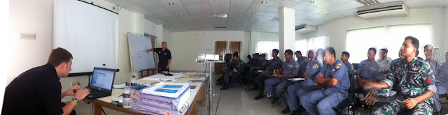 18 October 2012 - Bernie Mannings teaching a class of Bangladeshi coastguards (with Alex Evans at the laptop).  Photo credit: Dave Riley.