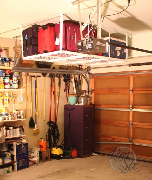 Storage over garage door with hanging rack