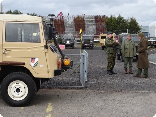 Re-enactors in uniform and military vehicles