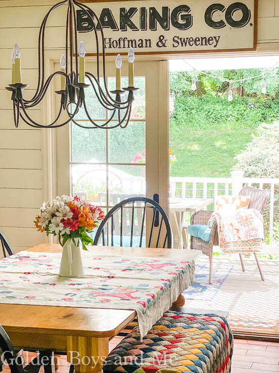 Farmhouse style kitchen with shiplap and Pottery Barn chandelier - www.goldenboysandme.com