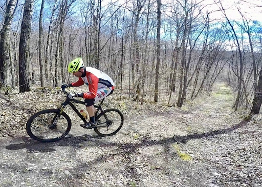 """Long time Maplelag team rider  climbing and cleaning """"kamikaze"""" hill"""