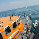 Poole's Tyne class City of Sheffield lifeboat with an alongside tow  Sunday 14 July 2013 Photo: RNLI Poole/Dave Riley