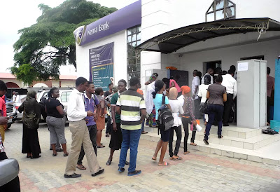 Lagosians queuing at an ATM, broke