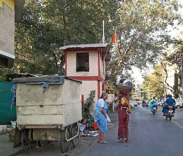 women selling utensils on road