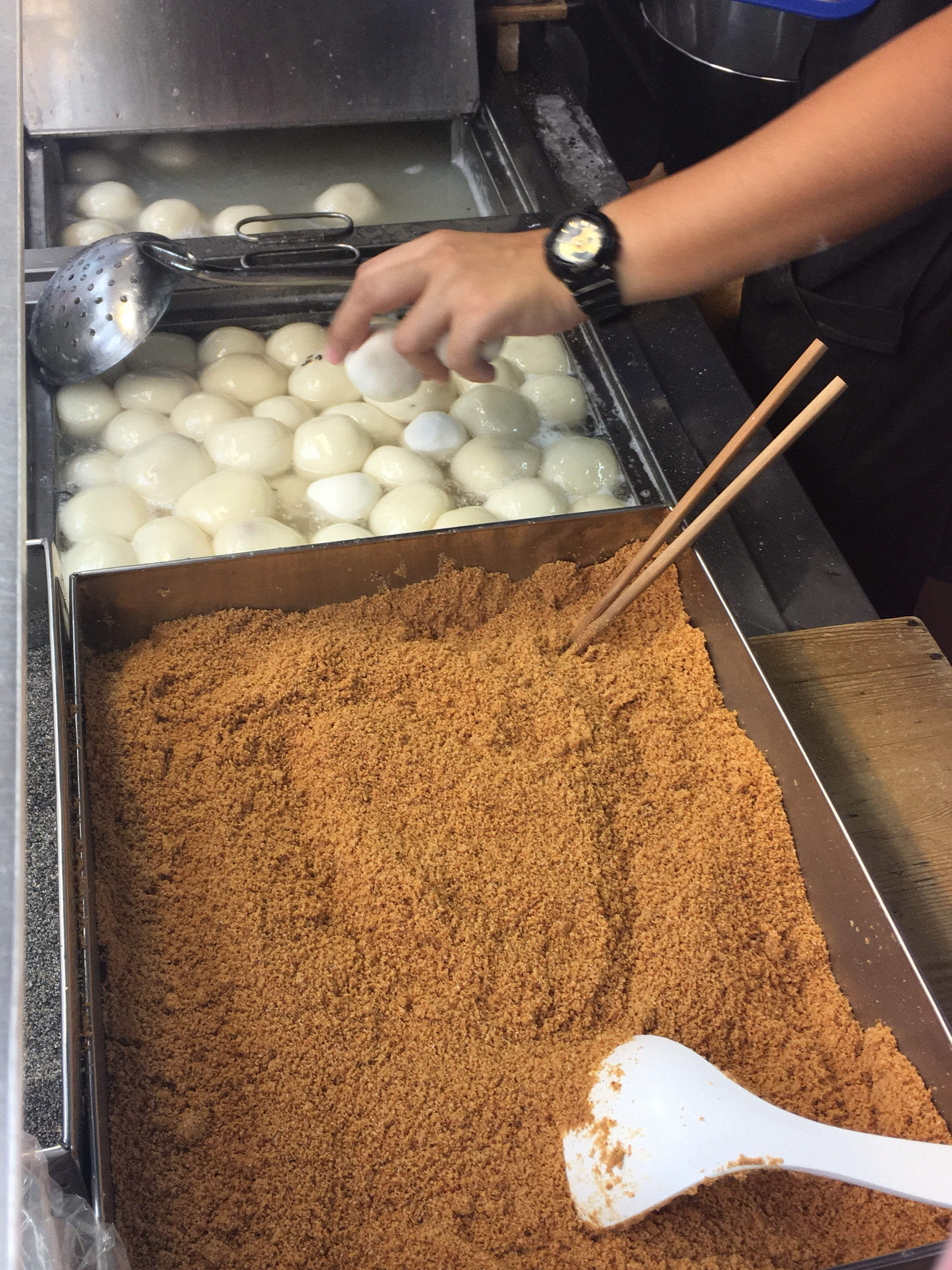boiled mochi with peanut sesame and covered with peanut