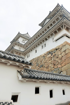 Himeji Castle also known as White Heron Castle (Shirasagijo) due to its elegant, white appearance. Below you can see windows for an archer or defender using a Matchlock