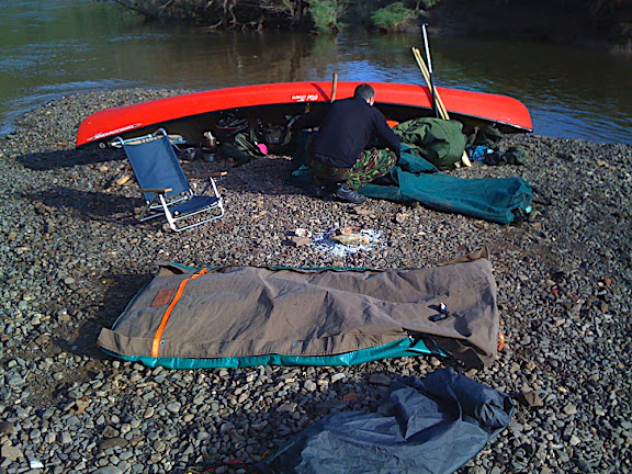 2 Australian swags, and one red Old Town Canoe