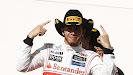 Lewis Hamilton wins the 2012 US F1 GP with Texas ranger Pirelli hat