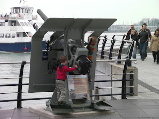 firing guns at the harbour entrance. do not climb on the gun