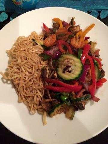 A bowl of noodles and stir fried vegetables