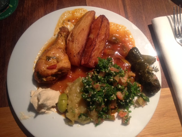 Chicken, tabouleh, stuffed vine leaves and wedges served up
