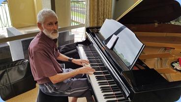 Errol Storey playing the Village's Kawai grand piano.