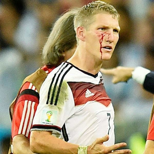 Germany's Bastian Schweinsteiger reacts as he comes off the pitch after getting injured during the World Cup final soccer match between Germany and Argentina at the Maracana Stadium in Rio de Janeiro, Brazil, Sunday, July 13, 2014.